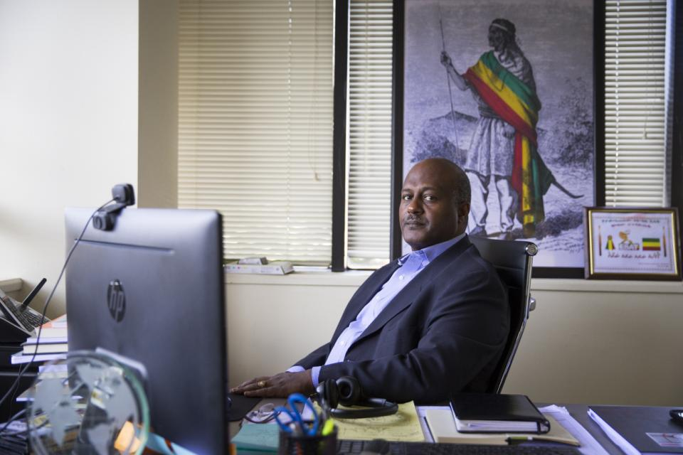 Ethiopian Satellite Television Executive Director Neamin Zeleke is seen in his office in Alexandria, Va., Monday, March 9, 2015. More than a year after researchers revealed an electronic eavesdropping campaign aimed at D.C.-area journalists, the hackers are at it again. Internet watchdog group Citizen Lab said in a report published Monday that hackers who attacked a U.S. employee of Ethiopian Satellite Television in 2013 have recently launched a new round of attacks using upgraded espionage software. (AP Photo/ Evan Vucci)