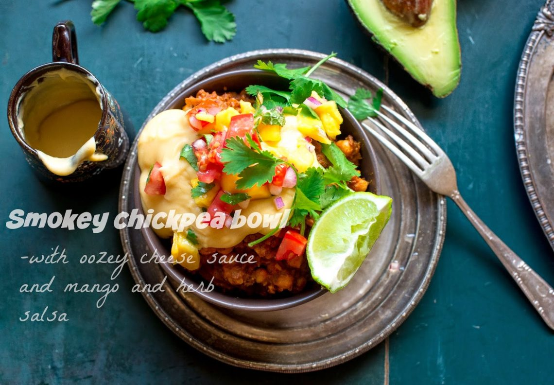 Smokey vegan chickpea bowl with oozey cheese sauce and mango salsa!