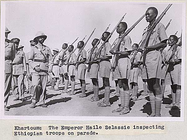 haile selassie inspects troops