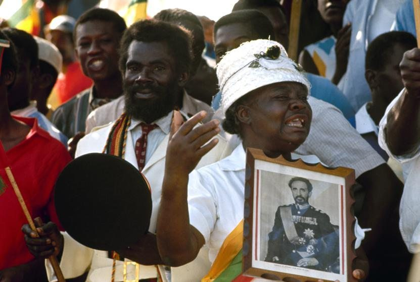 Woman crying among crowd of Rastafarians welcoming Ethiopian Emperor Haile Selassie to Jamaica.