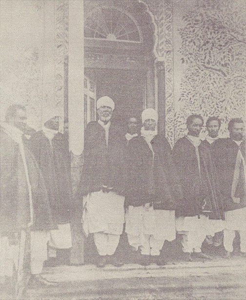 Lij Iyasu with several other senior members of the Ethiopian aristocracy and Menelik's government, namely (from left to right): 1. Negadras Yigezu Behabte 2. Fitawrari Habte Giyorgis Dinagde 3. Ras Bitwoded Tessema Nadew 4. Negadras Haile Giyorgis Woldemikael 5. Lij Iyasu 6. Wagshum Kebede Tafari 7. Leul Dejazmatch Haile Selassie Gugsa 8. Dejazmach Gebreselassie Bariagaber