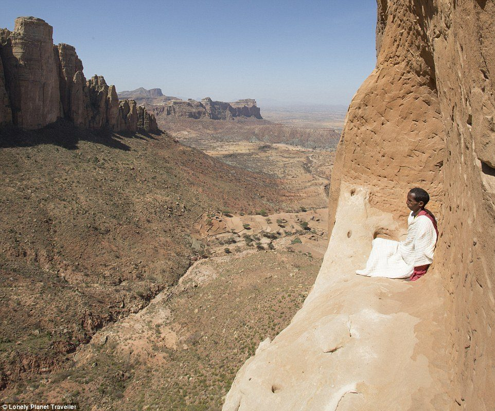 Church in the sky: A priest at Abuna Yemata Guh, a church 2,500 feet high on a clifftop in northern Ethiopia